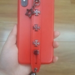 (701-010)เคสมือถือไอโฟน Case iPhone X เคสแฟชั่นสไตล์โรมันสีแดงพร้อมสายคาดมือด้านหลังโทรศัพท์
